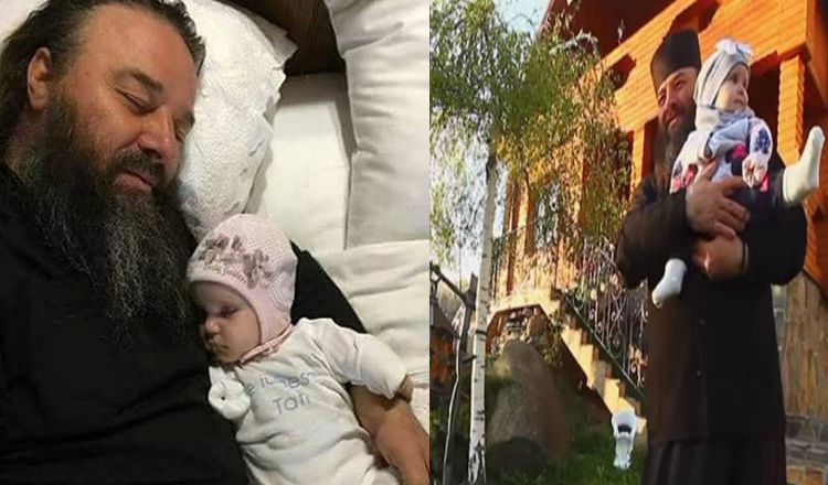 """Parintele Mihail, tata a peste 400 de copii, a infiat o fetita fara maini: """"Acest copil e cerul pentru mine!"""""""
